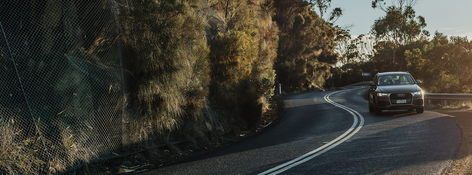 Car driving on windy road on Tasmania's east coast