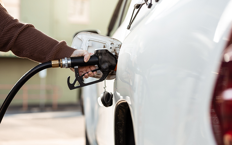 Person filling up a car with petrol